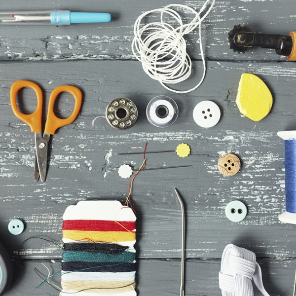 Background with sewing and knitting tools and accesories