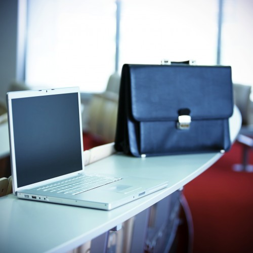 Laptop and handbag on desk on business conference. Taken on event Minilypse - Ljubljana - 2008. [url=http://www.istockphoto.com/file_search.php?action=file&lightboxID=1049019][img]http://santoriniphoto.com/Template-Modern-technology.jpg[/img][/url] [url=http://www.istockphoto.com/file_search.php?action=file&lightboxID=3944252][img]http://santoriniphoto.com/Template-Minilypse-Ljubljana-2008.jpg[/img][/url]